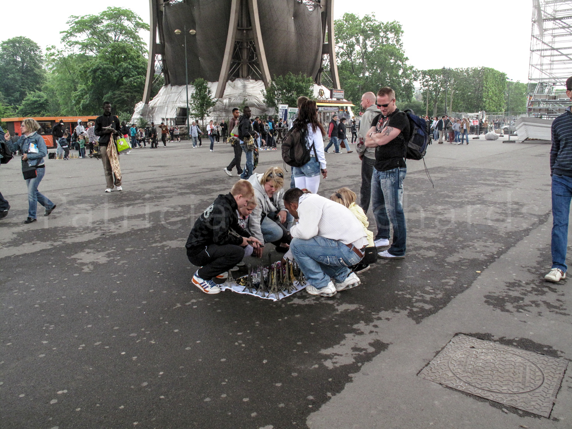 buying eiffel toweres beneath the eiffel tower